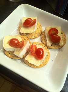 Ancient Grains Crackers topped with Double Cream Brie and tomato