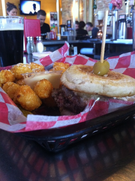 Truffle Burger - topped with brie and truffle oil on an English muffin with Parmesan truffle tater tots