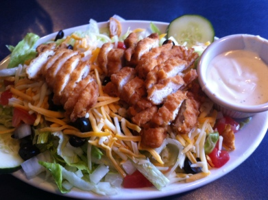 Chicken Finger Salad - chicken fingers, lettuce, onion, tomato, cucumbers, black olives & shredded cheese