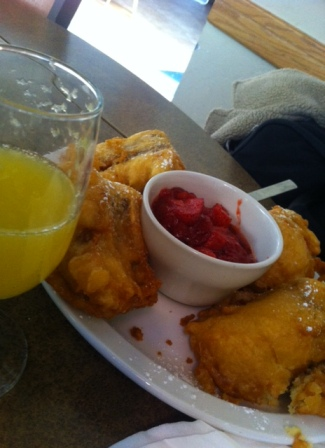 Breakfast Monte Cristo made with sausage and served with strawberry sauce