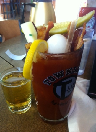 Breakfast Mary with bacon-infused vodka, cheese, beef stick, pickle, two slices of bacon, hard boiled egg and a beer chaser