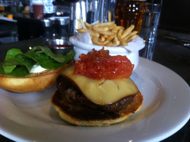 Eat Street Burger, half pound beef burger, smoked gouda, onion marmalade, preserved tomato, fries