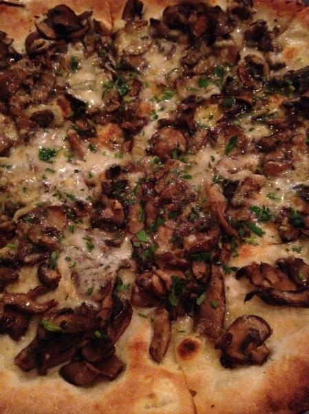The Forager crimini, shitake, and portabella mushrooms, taleggio, fontina, tarragon & truffle oil 15.5