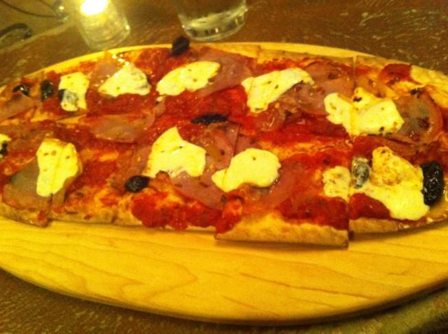 prosciutto, smoked mozzarella, olives, san marzano tomato sauce and red pepper flakes