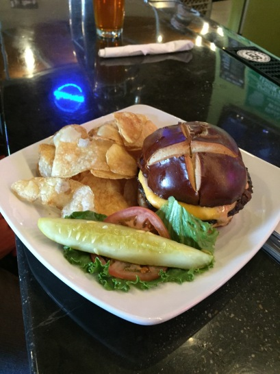Cheese Curd Burger$9.99Half pound grilled sirloin hamburger topped with fresh melted Wisconsin cheese curds, our specialty pub sauce, all on a pretzel kaiser bun.