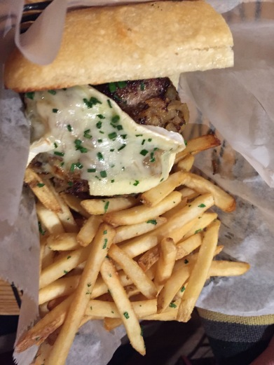 Cheeky Burger 12 grass-fed beef, caramelized onion, brie, toasted ciabatta roll, bistro fries