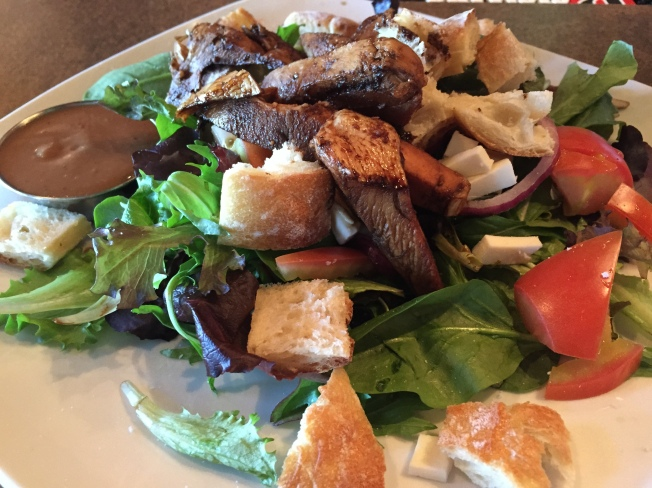 Balsamic Chicken Bread Salad balsamic chicken, rustic bread cubes, spring greens, red onion, fresh mozzarella, tomato, kalamata olives, dusted with parmesan and served with a honey balsamic vinaigrette