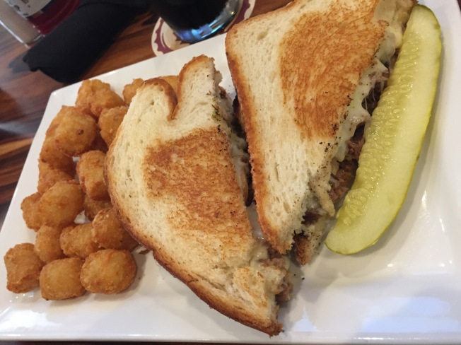 Brisket Grilled Cheese - slow roasted Texas-style brisket, sauteed onions, sharp cheddar and provolone cheese - $12