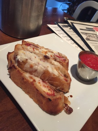 Pepperoni Roll - house cheese and pepperoni rolled in fresh dough w/fig balsamic vinegar - $7
