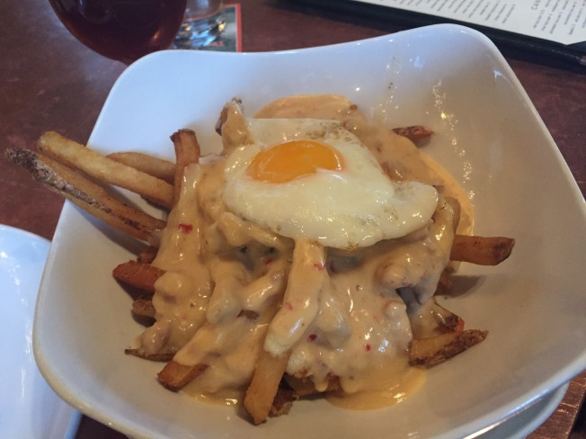 Breakfast - poutine - fries, sausage or mushroom gravy, cheddar curds, sunny egg - $9