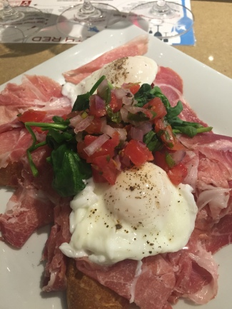 POACHED EGGS 12. with la quercia prosciutto, and sautéed spinach on grilled bread with roasted tomato salsa