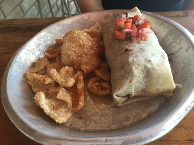Stuffed Burrito - burrito filling that includes fries, side of pork rinds