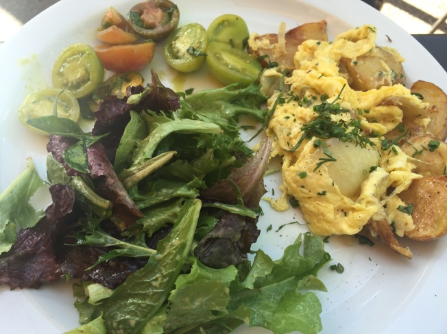 Farm Scramble $9.75 Roasted Yukon Gold potatoes scrambled with fresh eggs, herbs, onions, gruyere and white cheddar served with mixed greens and tomato salad