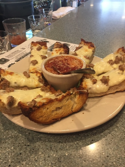 Garlic Cheese Bread A 1/2 loaf of grilled French bread brushed with garlic butter, topped with mozzarella cheese & baked. Served with marinara sauce for dipping. 7.95 Add sausage or pepperoni for 1.95