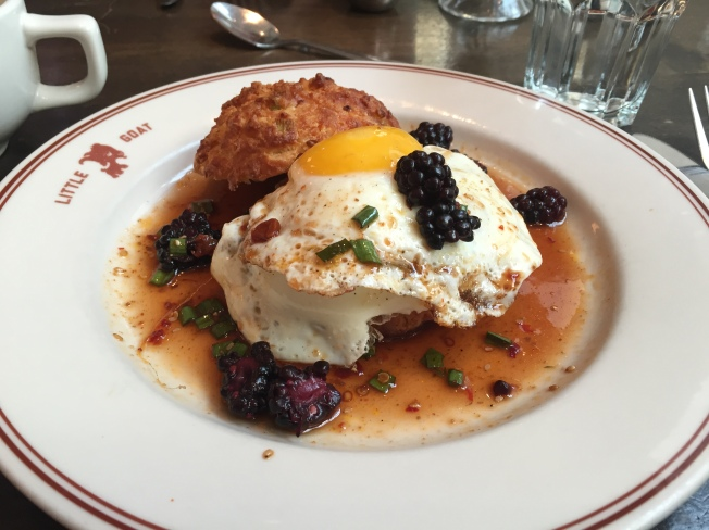 THIS LITTLE PIGGY WENT TO CHINA - $14.00 sesame cheddar biscuit. sunny eggs. szechuan pork sausage. chili garlic chive sauce. blackberries