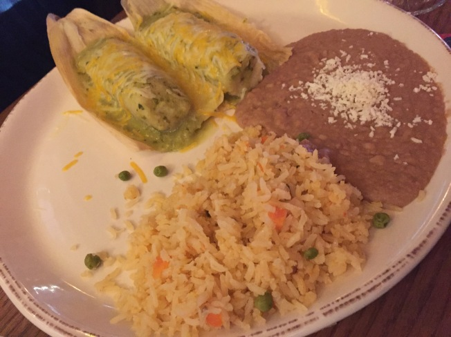 Tamales de Pollo two chicken tamales with green sauce, melted cheese, served with Spanish rice and refried beans. Ala carte 12.95