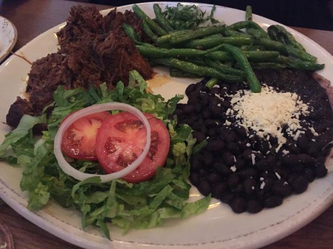 Plato de Barbacoa slowly braised beef with avocado leaf, onion, tomato, pickled jalapeños 16.95