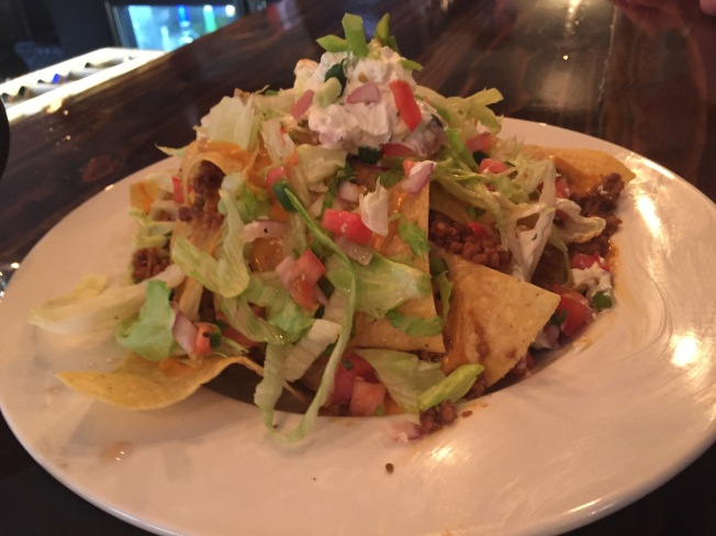 NACHOS 10 Homemade Tortilla Chips, Chipotle Cheese, Lettuce, Pico de Gallo, Cilantro Lime Sour Cream Add Chicken or Beef 2